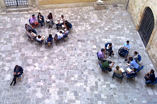ICNL 2011-2012 Annual Report Cover photo - Groups of people meeting in a court yard