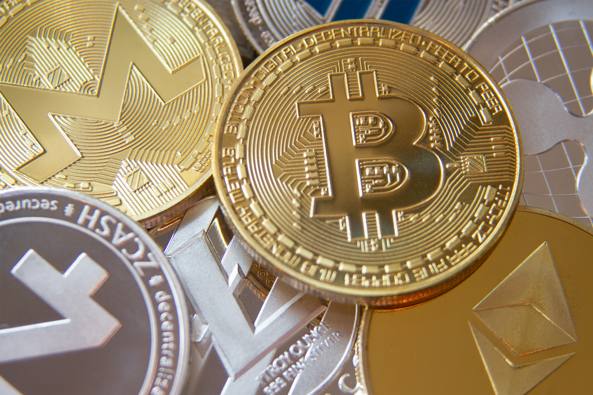 Pile ofcryptocurrency coinsincluding Bitcoin, Monero, ZCash, Ethereum, Litecoin, Ripple, and Dash. (Photo: QuoteInspector/Flickr)