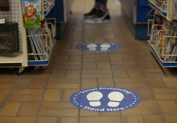Social distancing sign at drugstore (Photo: GoToVan/Flickr)