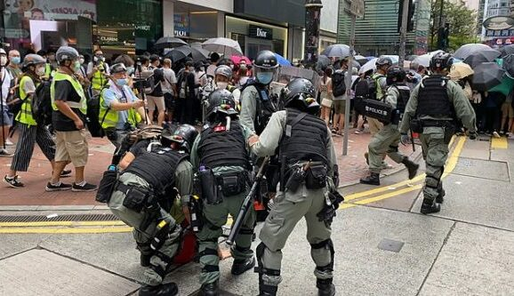 Protesters in Hong Kong getting arrested by police, July 2020. (Photo: Studio Incendo/Wikimedia)