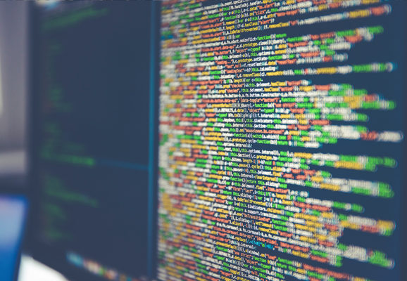 Colorful code on computer monitors (Photo: Markus Spiske/Unsplash)