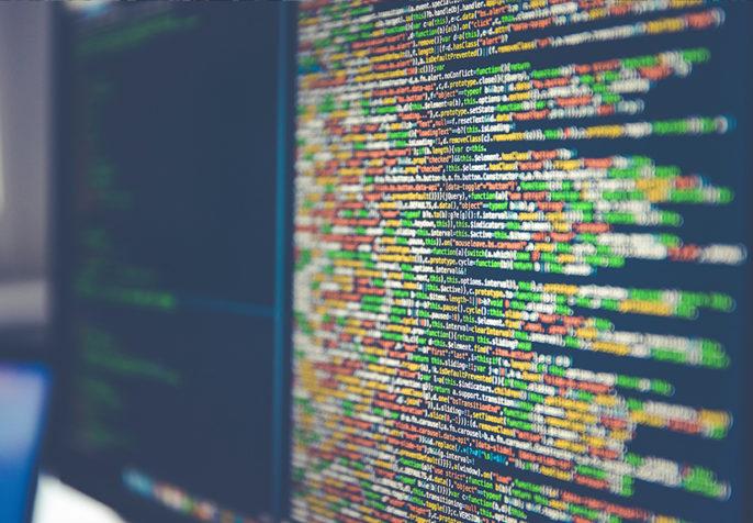 Colorful code on computer monitors (Photo: Markus Spiske/Unsplash)