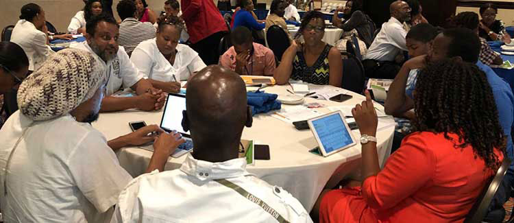 Stakeholders from civil society, government, and academia discuss the reform of social entrepreneurship laws in Jamaica using ICNL-generated resources. (Photo credit: ICNL)