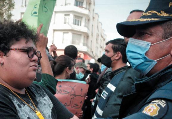 Tunisian women staring at masked Tunisian police (photo credit: shutterstock.com)