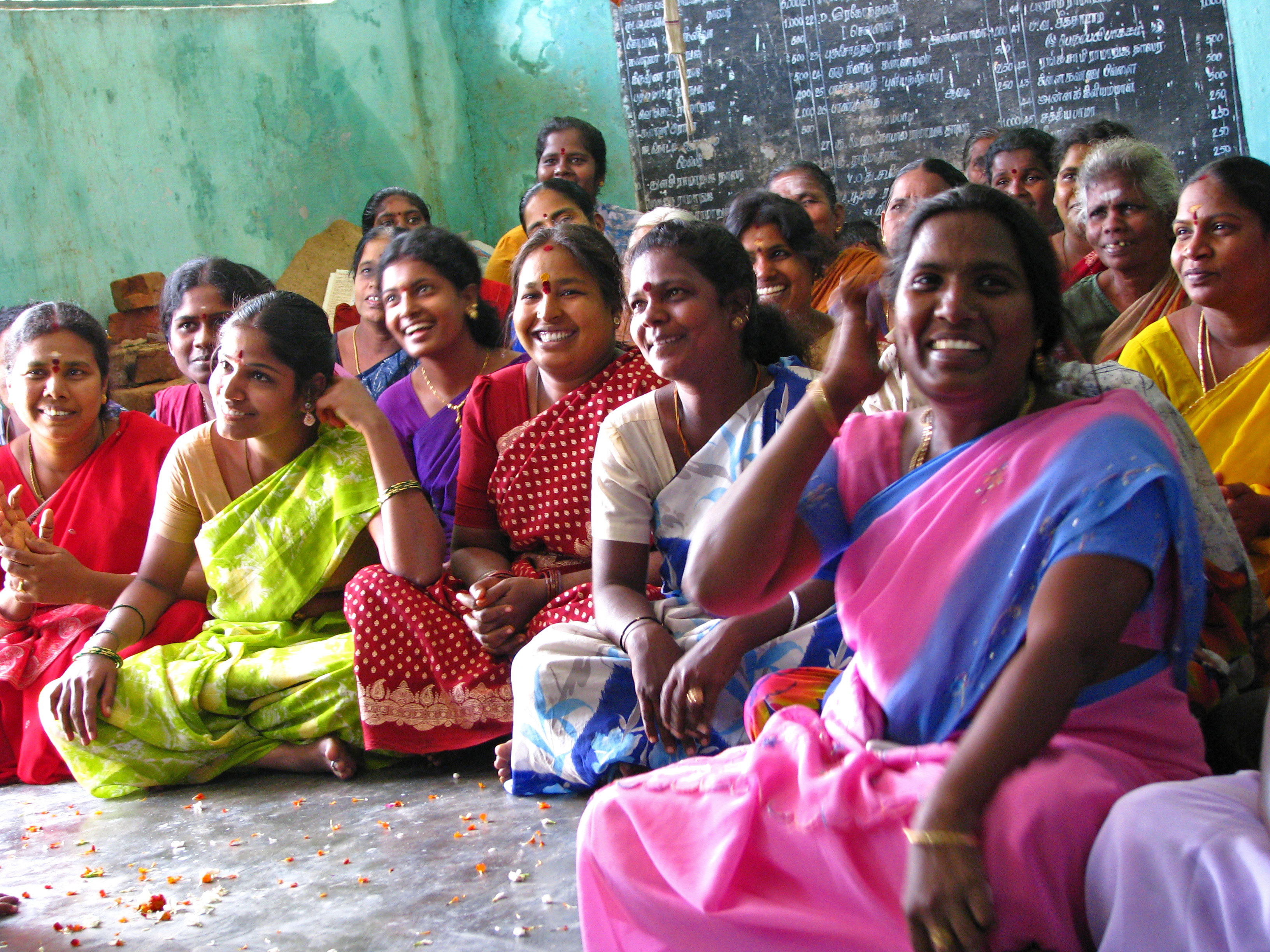 ICNL 2009-2010 Annual Report cover photo - A women's savings group meeting