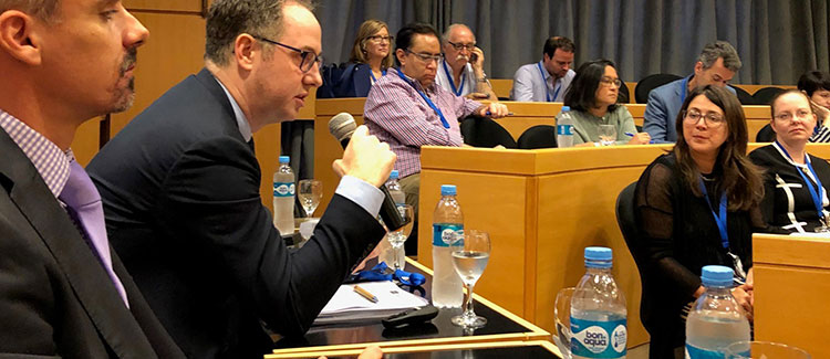 At a high-level event on the margins of the November 2018 G20 Summit, the executive secretary of the Financial Action Task Force, David Lewis, explains that governments must collaborate with civil society organizations to mitigate barriers to financial services. (Photo credit: ICNL)