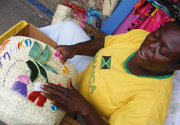 A woman displaying crafts in Jamaica (Photo Credit: Mary Sauers)