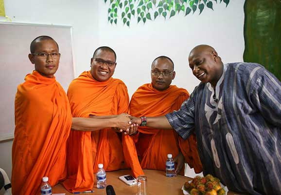 UN Special Rapporteur Maina Kiai meets with Buddhist monks in Cambodia during his visit to the country in February 2014 (photo credit: Jeff Vize)