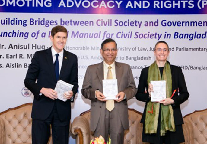 US Ambassador to Bangladesh Mr. Earl Miller, Mr. Anisul Huq, Minister, Law, Justice and Parliamentary Affairs, and DFID Senior Governance Adviser Ms. Aislin Baker were special guests at the Building Bridges between Civil Society and Government launch event in Dhaka, Bangladesh. (Photo: CPI)
