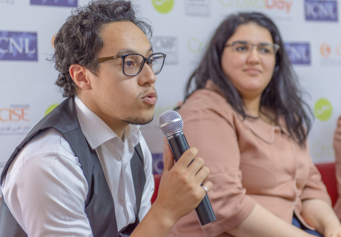 """A speaker at an ICNL-supported workshop on crowdfunding in Morocco, May 2018. One participant concluded that the legalization of crowdfunding """"could have a truly positive impact on Morocco's development."""" (Photo credit: ICNL)"""