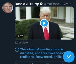"A screenshot of Donald Trump tweet from January 6, 2021 that shows a clip of his video expressing false information about the 2020 US Presidential Election. The tweet has a disclaimer under it from Twitter that reads: ""This claim of election fraud is disputed, and this tweet can't be replied to, retweeted, or liked."""