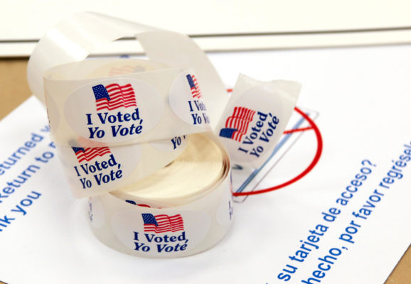'I Voted' sticker spool on top of a ballot envelope. Stickers have an American flag on them and are in English and Spanish. (GPA PHOTO ARCHIVE/Flickr)